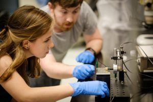 Wake Forest students work in the research lab of physics professor Oana Jurchescu in Olin Hall on Wednesday, October 11, 2017. Katrina Barth ('18) and graduate student Zach Lamport work with a tiny experimental chip.